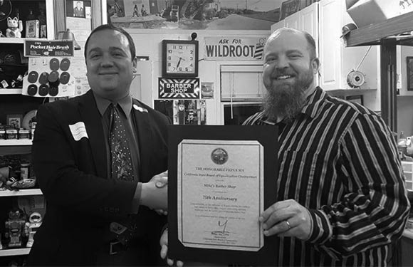 Mike's Barber Shop receives two awards at the 75th anniversary celebration